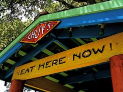 Chuy's sign with text Eat Here Now